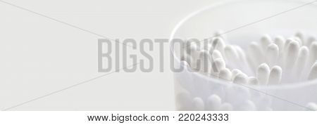 White cotton tipped swabs in box. Ear sticks close up. Soft focus image. Copy space. macro view.