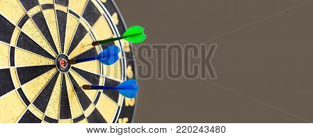 Dart board competition. Hitting target aim, goal achievement blue green stings. Retro design sport game, copy space.