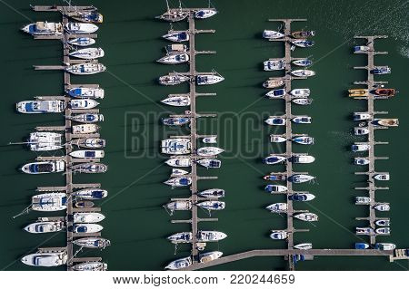 Aerial view of sail boats docked in a Marina in Portimao, Algarve; Concept for travel in Portugal and luxury summer vacations
