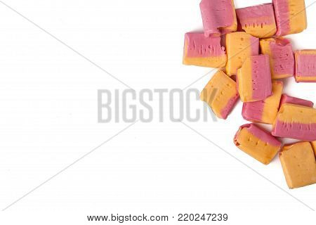 Fruit salad flavor candy chews on white background with copy space