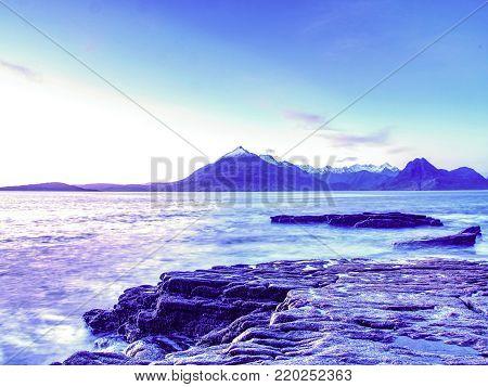 Rocks near Elgol,  Loch Scavaig,  Isle of Skye Scotland. Warm sunset colors in cold February evening. Popular photographers destination.
