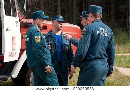 Yartsevo, Russia - August 26, 2011: Employees of the Ministry of Emergency Situations Russia speak at the fire engine