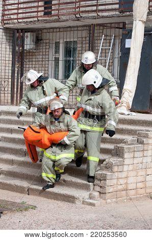 Yartsevo, Russia - August 26, 2011: Firefighters evacuated the injured