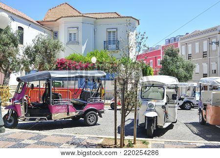 Lisbon, Portugal - August 06, 2017: Many taxis Tuk Tuk on the road of Lisbon waiting the Tourists at Lisbon