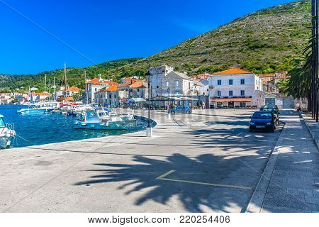 Scenic view at picturesque Vis town in Southern Croatia, popular summer tourist resort in Mediterranean, Europe.