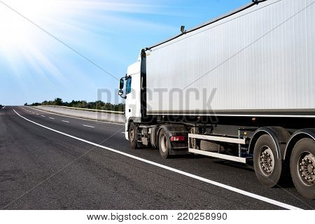 Truck on road with grey container, cargo transportation concept
