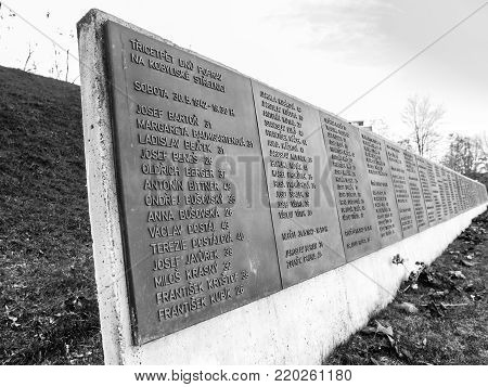 PRAGUE, CZECH REPUBLIC - DECEMBER 9, 2017: List of victims in former Kobylisy Shooting Range, Prague, Czech Republic. Place of mass executions during WWII by Nazis after the assassination of Reinhard Heydrich. Black and white image.