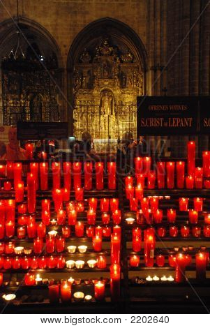 red votive candles inside main cathdral of Barcelona poster