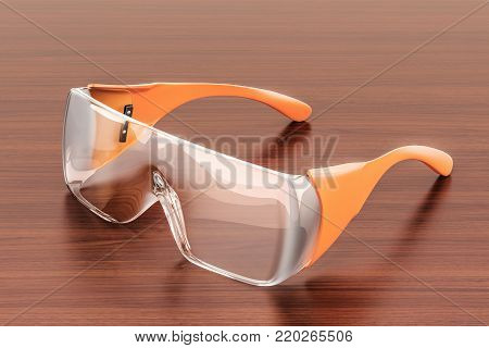 Safety glasses on the wooden table. 3D rendering