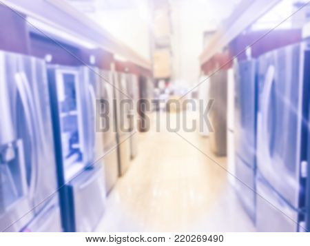 Blurred Retail Store With Rows Of French Door Refrigerators With Ice Makers