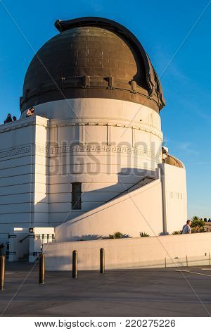 LOS ANGELES, CALIFORNIA - NOVEMBER 19, 2017:  A dome housing a Zeiss 12-inch refracting telescope at Griffith Observatory, a popular destination with free nightly public telescope viewing.