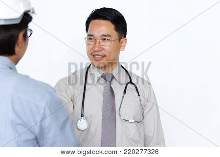Photograph Of Doctor And Engineer Meeting And Shakehand On Solid White Background.