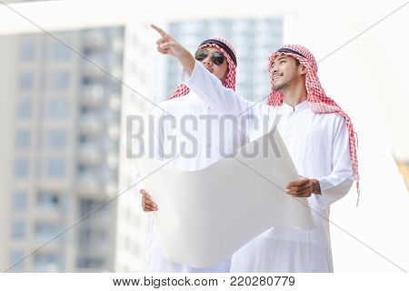 Arab business man looking working on plan peper in the city