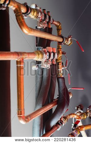 Copper pipes and valves in a boiler room. Close up.