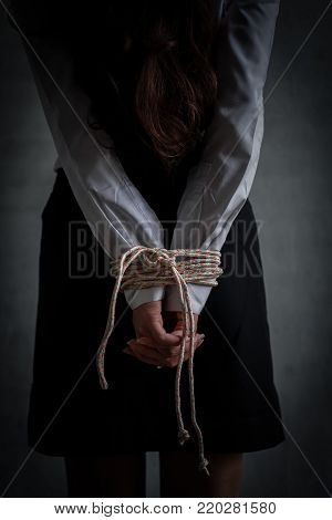 Woman hostage tied with rope sexual robber concept, bandit sexual abuse or female in abandoned house