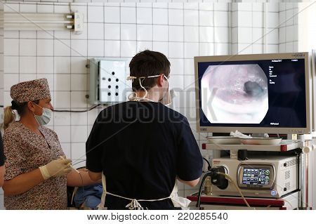 City Gomel, Belarus,April 13, 2017,Oncological hospital, department of iodine treatment,Doctors make endoscopy, look at the monitor screen.Diagnosis of the stomach