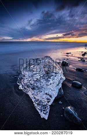 Beautiful sunset over famous Diamond beach near Jokulsarlon lagoon, Iceland, long exposure.