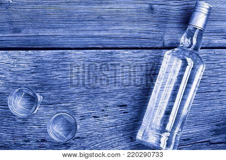 Black and white photo. VODKA luxury. Vodka in a bottle and glasses on a background of wood.top view