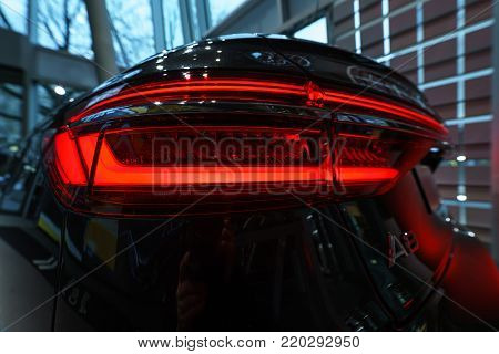 BERLIN - DECEMBER 21, 2017: Showroom. The rear lights of the full-size luxury car Audi A8 3.0 TDI quattro (286PS). Since 2018.