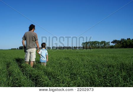 Man And Boy In Wheat Field