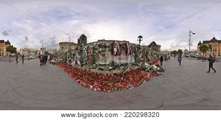 BUCHAREST, ROMANIA - DECEMBER 16, 2017: 360 Panorama of Piata Revolutiei with Heaps of flowers, candles and leaflets put in front of the Royal Palace in rememberance of the deceased king, Michael I.
