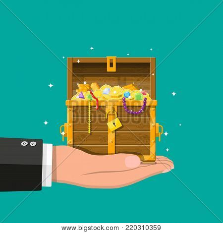 Opened chest with padlock in hand. Chest full of gold coins, jewelry, gems. Wooden treasure box. Symbol of wealth. Vector illustration in flat style