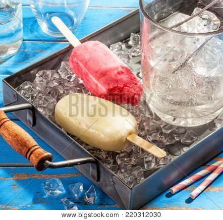 Homemade ice cream pops on a summer table.