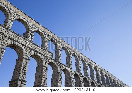 an old stone aqueduct in Segovia, Spain