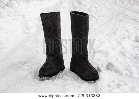 Felt boots on the snow. The traditional Russian winter footwear - valenki