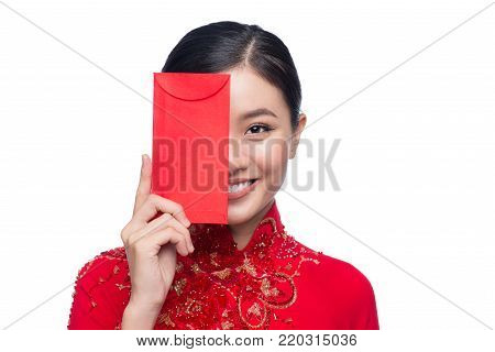 Portrait Of A Beautiful Asian Woman On Traditional Festival Costume Ao Dai Holding Red Pocket - Luck