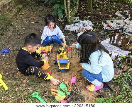 Asian Kids Playing At Garden