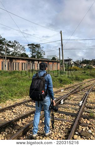 A Man Walking On Rail Track
