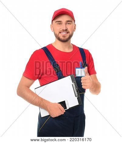 Handsome auto mechanic with clipboard showing thumb-up gesture on white background
