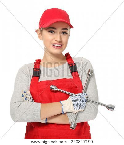 Female auto mechanic with lug wrench on white background