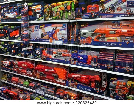 Amsterdam, The Netherlands - January 2, 2018: assortment of various NERF foam-based weaponry on a toys store shelf.