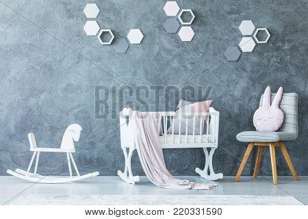 White Cradle In Child's Bedroom