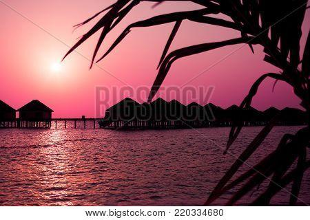 Luxury Water Lodges At Sunset On Maldive