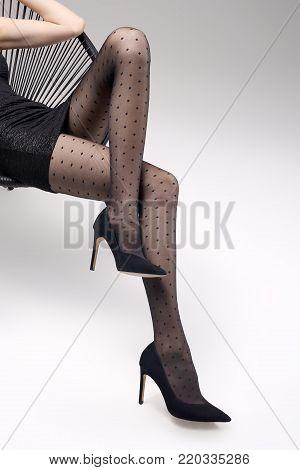 Black tights, beautiful female legs. Female legs in pantyhose and black high heels