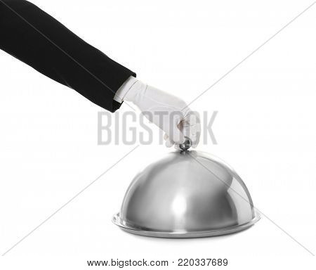 Waiter's hand and cloche with metal tray against white background