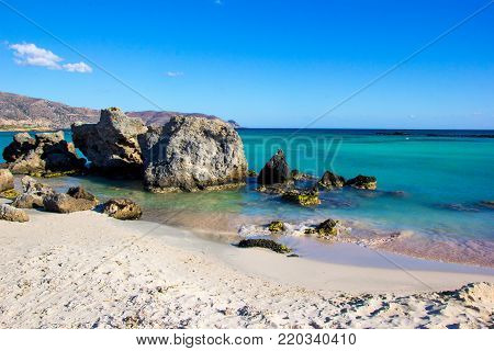 Natural background. Coast of Crete - Grecian island, blue cloudless sky, fascinating turquoise water and nobody