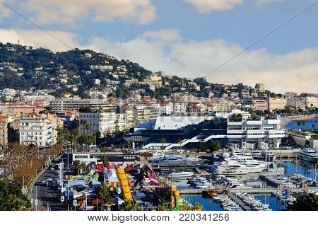 CANNES, FRANCE - DECEMBER 31, 2016: View of Le Suquet,- the old town, Winter Carnaval, and Port Le Vieux of Cannes, France