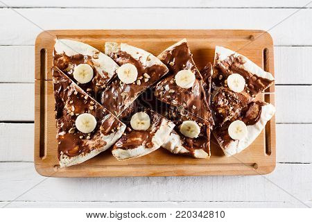 Dessert or breakfast pizza with nutella picture