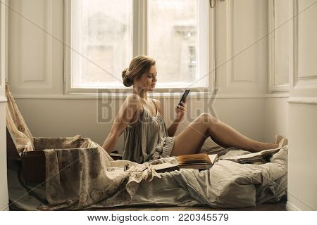Elegant woman reading a text message