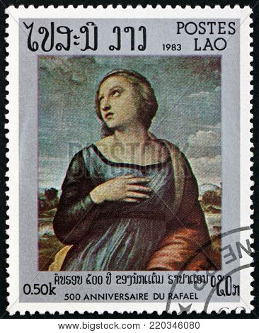 LAOS - CIRCA 1983: a stamp printed in Laos shows St. Catherine of Alexandra, painting by Raphael, circa 1983