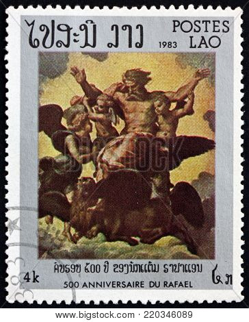 LAOS - CIRCA 1983: a stamp printed in Laos shows vision of Ezekiel, painting by Raphael, circa 1983