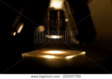 Microscope Objective With A Slide And A Dark Background