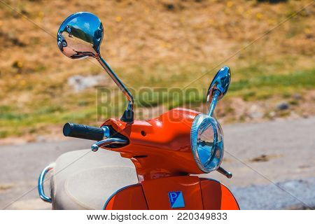Portugal, Madeira, July 04, 2016: Red scooter Vespa parked in the mountains on Madeira Island, Portugal