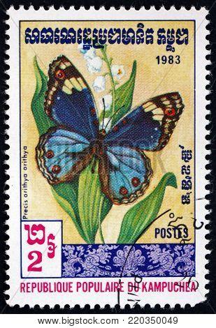 CAMBODIA - CIRCA 1983: a stamp printed in Cambodia shows blue pansy, precis orithya, butterfly, circa 1983