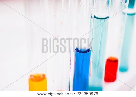 test tubes in laboratory. drug discovery, pharmacology and biotechnology concept. science and medical research background. poster