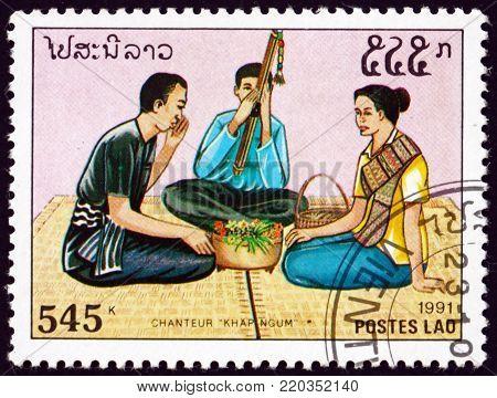 LAOS - CIRCA 1991: a stamp printed in Laos shows man and woman singing khapngum, circa 1991